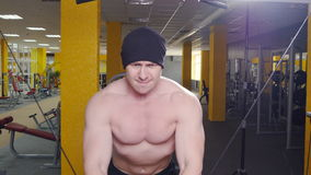 The man trains biceps in the gym stock video footage