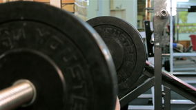 A man trains in a gym stock footage