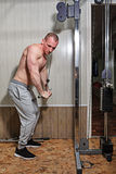 Man trains in gym Stock Photography