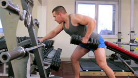 A man trains in a gym closeup stock video footage