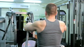 A man trains in a gym closeup stock footage