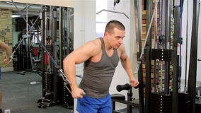 A man trains in a gym closeup stock video