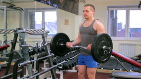 A man trains in a gym stock video