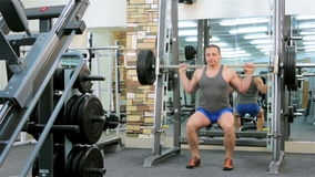 A man trains in a gym stock video footage