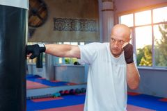 A man trains at the MMA bag to work out the bumps stock images