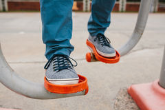 A man trains on sporting equipment in a city in the open air. The concept of a healthy lifestyle and accessibility of. Sports training for every person Stock Photos