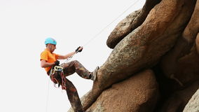 Man Trains to Conquer the Rock. Rock Climber Format stock video