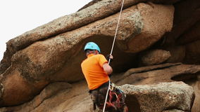Man Trains to Conquer the Rock. Rock Climber Format stock video footage