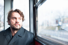 Man on a tram looking out the window Royalty Free Stock Image