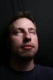 Man in a trance. Spotlight shining down on him Stock Photo