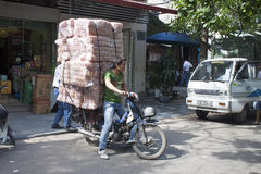 Man transports huge load Stock Photo