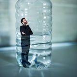 Man trapped inside plastic bottle. Plastic free concept