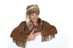 Man in trapper costume Royalty Free Stock Photography