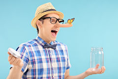 Man trapping a butterfly in a jar Stock Photos