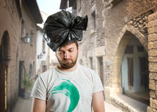 Man with trash pack on his head. Sad man with trash pack on his head on the street Stock Photos