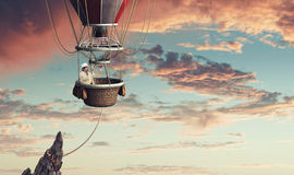 Man travel in aerostat Stock Photography