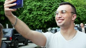 Man travel in Europe. Traveler using mobile phone, make vlog and live in social media