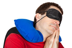 Man with travel Neck Pillow and Sleeping mask. Sleep in a armchair Royalty Free Stock Image