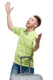 Man with travel suitcase with arms outstretched Royalty Free Stock Photos