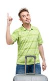 Man with travel suitcase attention gesturing Royalty Free Stock Photography