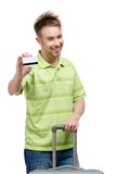 Man with travel suitcase and credit card Royalty Free Stock Photography