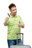 Man with travel suitcase and credit card thumbs up Royalty Free Stock Photos