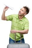 Man with travel suitcase and paper airplane Stock Photography