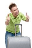 Man with travel suitcase thumbs up Stock Photo