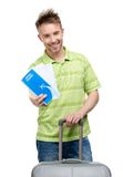 Man with travel suitcase and ticket Stock Photo