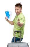 Man with travel suitcase and ticket thumbs up Stock Photography