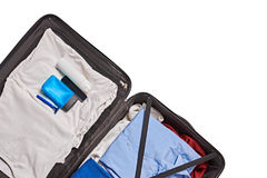 For man travel. Top view of male clothes and accessories for travel in valise Stock Photography