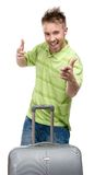 Man with travel trunk thumbs up Stock Photography