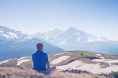 Man traveler  admiring a epic view of peaks Stock Image