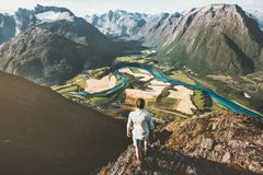 Man traveler alone standing on cliff Stock Images