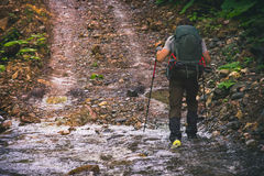 Man Traveler with backpack hiking outdoor Travel Lifestyle stock photography