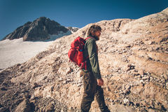 Man Traveler with backpack hiking outdoor Travel Royalty Free Stock Photo