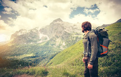 Man Traveler with backpack hiking Travel Lifestyle. Concept mountains on background Summer journey adventure vacations outdoor royalty free stock images