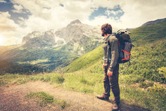 Man Traveler with backpack hiking Travel Lifestyle. Concept mountains on background Summer journey adventure vacations outdoor royalty free stock photo