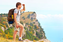 Man Traveler with backpack looking forward outdoor Stock Image