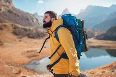 Man Traveler with backpack mountaineering . royalty free stock photo