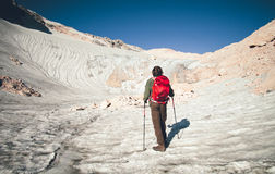 Man Traveler with backpack mountaineering glacier Royalty Free Stock Photography