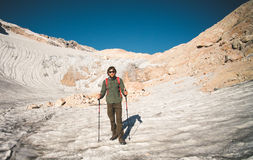 Man Traveler with backpack mountaineering glacier Stock Images