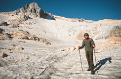 Man Traveler with backpack mountaineering glacier Royalty Free Stock Image