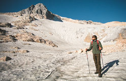 Man Traveler with backpack mountaineering glacier Stock Photography