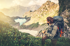Man Traveler with backpack mountaineering. Travel Lifestyle concept lake and mountains landscape on background Summer vacations adventure outdoor Stock Photos