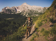 Man Traveler with backpack mountaineering Travel. Lifestyle concept mountains on background Summer vacations activity outdoor royalty free stock photography