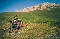 Man Traveler with backpack relaxing outdoor Travel Lifestyle concept stock photography