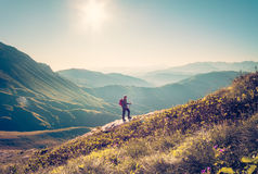 Man Traveler with backpack trekking Travel Lifestyle Royalty Free Stock Images