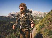 Man Traveler bearded with backpack mountaineering Royalty Free Stock Photo