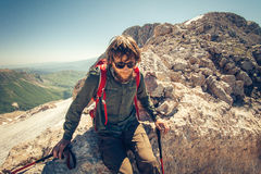 Man Traveler bearded with backpack relaxing. Travel Lifestyle concept mountains on background Summer vacations activity outdoor stock photo